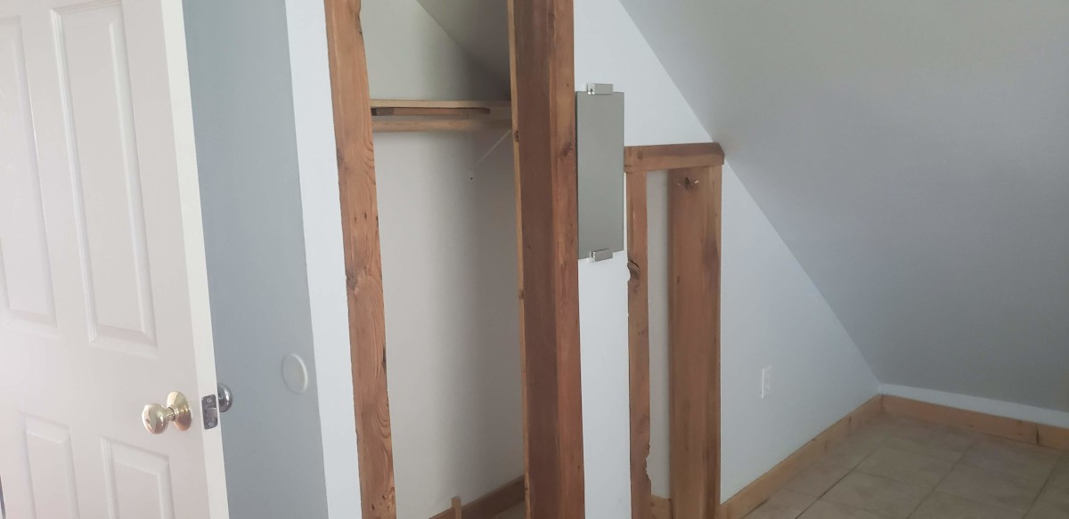upstairs closet. The second smaller door is what was the original attic access