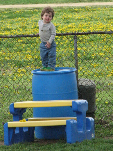 Cohen standing on barrel